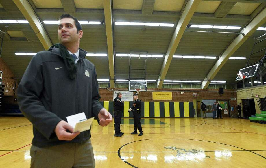 Norwalk varsity boys basketball coach Tom Keyes holds a summons issued by Stamford Police, following an incident that occur following the playing of the freshman boys basketball game at Trinity Catholic High School on Friday, Jan. 12, 2018. Photo: Matthew Brown / Hearst Connecticut Media / Stamford Advocate