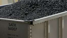 A train car loaded with Wyoming coal arrives at the CPS coal burning plant on Calaveras Lake on Tuesday, August 5, 2008. JERRY LARA/glara@express-news.net