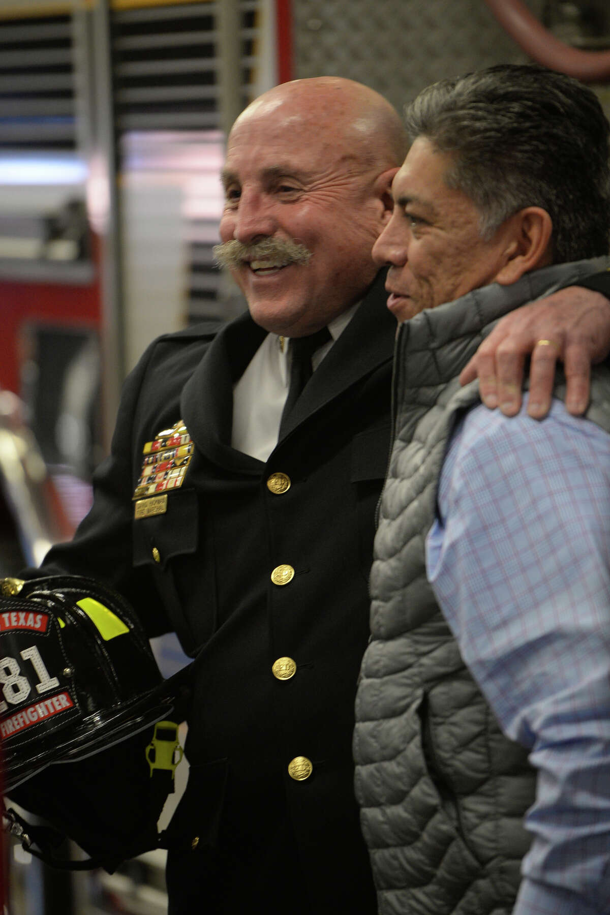Midland Fire Department's David Hickman hugs Midland Mayor Jerry Morales during a retirement party in Hickman's honor Jan. 12, 2018 at the Midland Fire Department central station. James Durbin/Reporter-Telegram