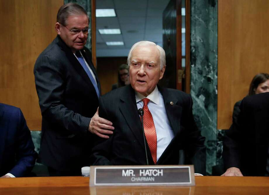 Senate Finance Committee chairman Sen. Orrin Hatch, R-Utah, is greeted by Sen. Robert Menendez, D-N.J., as he takes his seat before the start of a Senate Finance Committee hearing on Capitol Hill on Jan. 9, 2018. (AP Photo/Carolyn Kaster) Photo: Carolyn Kaster, STF / Copyright 2018 The Associated Press. All rights reserved.