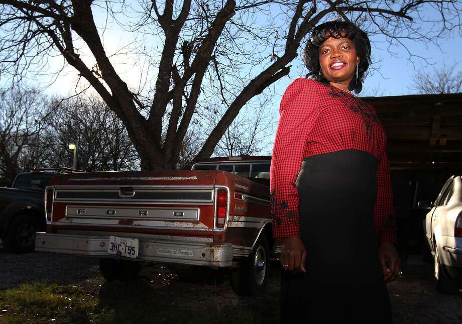 Doris Callies Dunlap stands beside a truck that her father, the late Rev. R.A. Callies, used for the first marches in honor of Martin Luther King Jr. in San Antonio. The Rev. Callies is credited as a founder of the march, leading a small procession in 1968. Photo: Kin Man Hui / San Antonio Express-News / SAN ANTONIO EXPRESS-NEWS