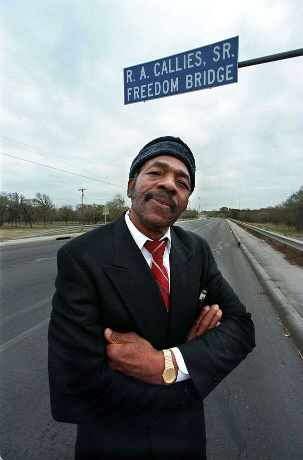 Rev. R.A. Callies stands under the sign naming the Freedom Bridge the R. A. Callies Freedom Bridge. Doris Callies Dunlap, Rev. Callies' daughter, remembers her accomplished father on Martin Luther King, Jr. Day. Photo: BOB OWEN /SAN ANTONIO EXPRESS-NEWS / SAN ANTONIO EXPRESS-NEWS