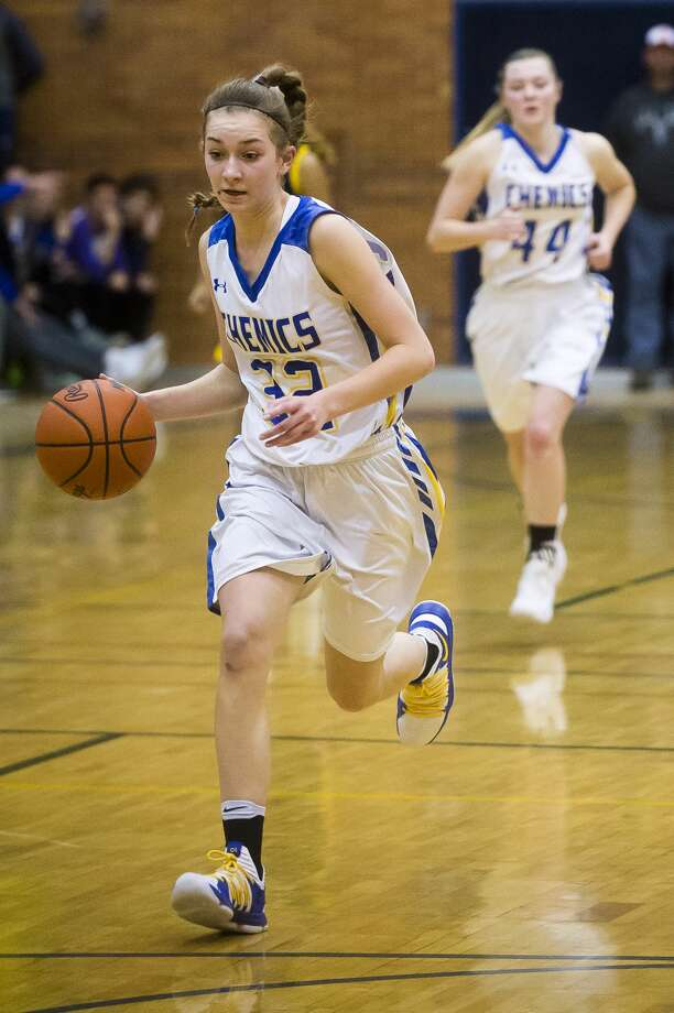 Midland freshman Anna Tuck dribbles down the court during the Chemics' game against Mt. Pleasant on Friday, Jan. 12, 2018 at Midland High School. (Katy Kildee/kkildee@mdn.net) Photo: (Katy Kildee/kkildee@mdn.net)