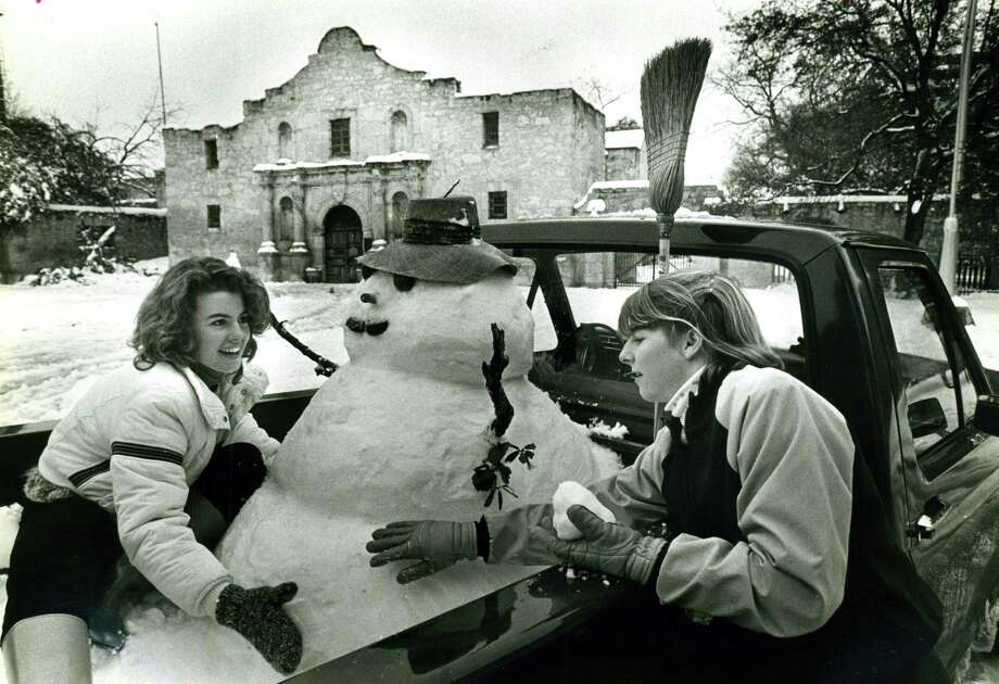 Snow and a snowman in front of the Alamo Jan. 12, 1985. Lolly Flowers (left) and Leslie Roberts built the snowman in the back of a friend's truck parked by the Alamo. Photo: File Photo / Express-News