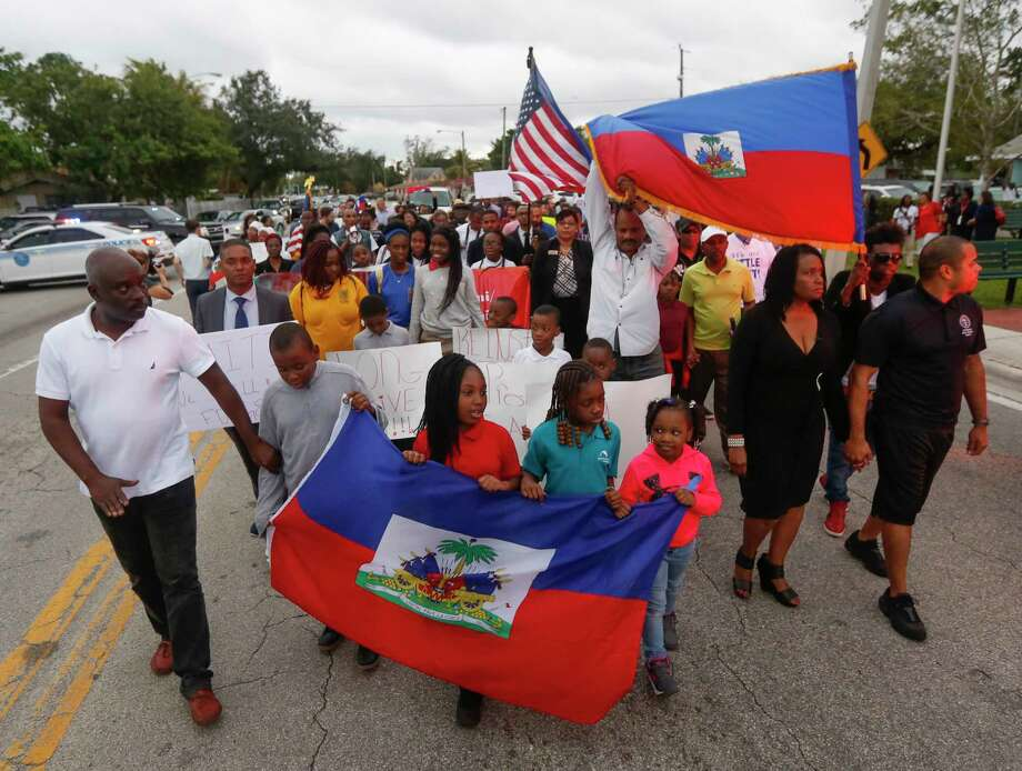 Marchers in Miami's Little Haiti neighborhood mark the eighth anniversary of the devastating Haitian earthquake - and protest President Donald Trump's disparaging remarks about the Caribbean country. Must credit: Photo by Andrew Innerarity for The Washington Post Photo: Andrew Innerarity, For The Washington Post / Andrew Innerarity