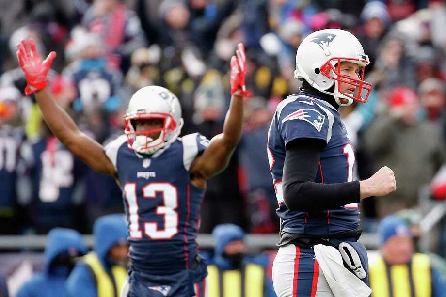 FOXBORO, MA - DECEMBER 31:  Phillip Dorsett #13 and Tom Brady #12 of the New England Patriots celebrate after a rushing touchdown by Dion Lewis #33 (not pictured) during the first quarter against the New York Jets at Gillette Stadium on December 31, 2017 in Foxboro, Massachusetts.  (Photo by Jim Rogash/Getty Images) Photo: Jim Rogash / 2017 Getty Images