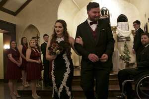 Morgan Workman and Kyle Workman walk towards their guests after being married by Pastor Frank Pomeroy at Spinelli's in Comfort on Thursday, Jan. 11, 2018.