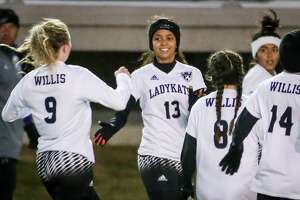 Willis' Crisely Pavon (13) celebrates with teammates after scoring a goal during the girls soccer game against Vidor on Friday, Jan. 12, 2018, at Yates Stadium in Willis. (Michael Minasi / Houston Chronicle)