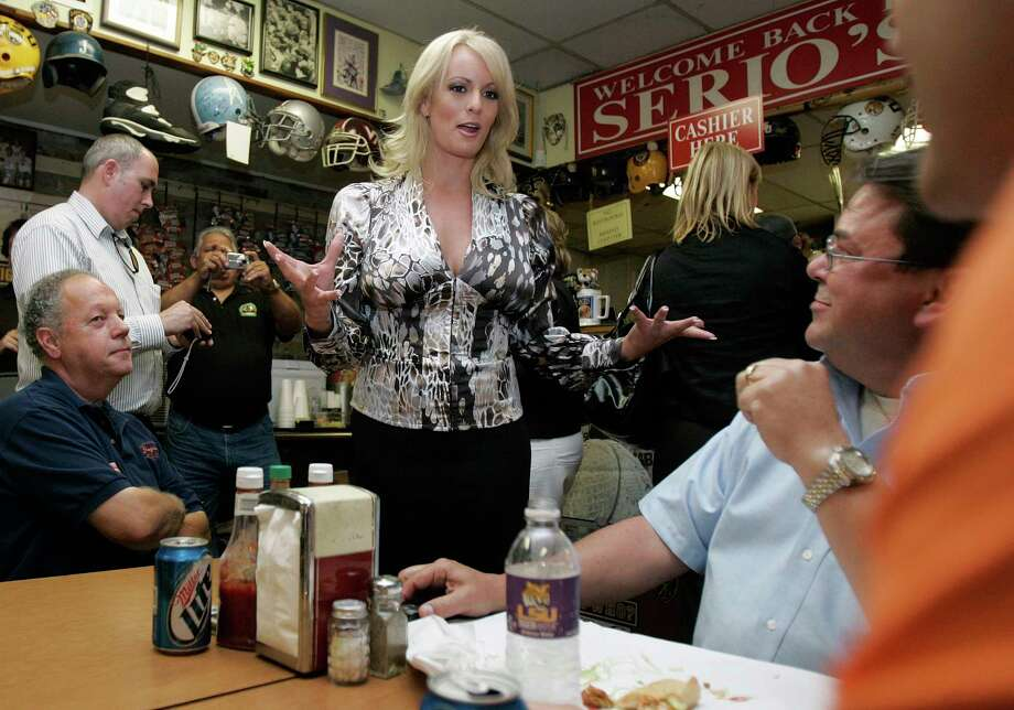 Stormy Daniels visits a local restaurant in downtown New Orleans,  Wednesday, May 6, 2009.  Daniels, an adult film star, is exploring the possibility of challenging incumbent Louisiana U.S>.Sen. David Vitter when Vitter stands for re-election. (AP Photo/Bill Haber) Photo: Bill Haber, STF / AP