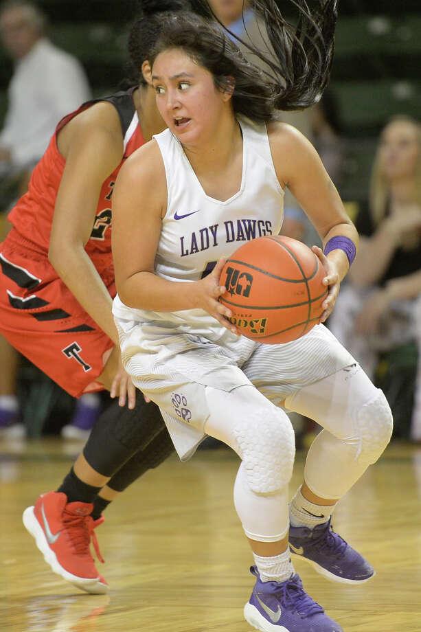 Midland High's Maya Duarte (10) changes direction against Amarillo Tascosa on Jan. 12, 2018, at Chaparral Center. James Durbin/Reporter-Telegram Photo: James Durbin