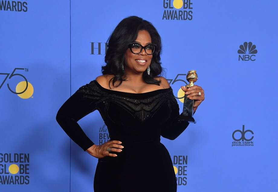 Oprah Winfrey with the Cecil B. DeMille Award during the 75th Golden Globe Awards in Beverly Hills on Jan. 7. Photo: FREDERIC J. BROWN, AFP/Getty Images