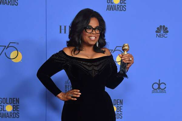 (FILES) This file photo taken on January 7, 2018 shows actress and TV talk show host Oprah Winfrey with the Cecil B. DeMille Award during the 75th Golden Globe Awards in Beverly Hills, California. Americans may love Oprah Winfrey, but most don't want the chat show queen to run for president, although if she did she would beat Donald Trump, a poll revealed on January 12, 2018. Winfrey's rousing speech at Sunday's Golden Globe Awards ceremony ignited speculation that the billionaire entertainment mogul, the first black woman to own a television network, is harboring Oval Office ambitions.  / AFP PHOTO / Frederic J. BROWNFREDERIC J. BROWN/AFP/Getty Images