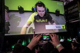 Houston Outlaws player Austin Wilmot is shown on the screen during a watch party for the Outlaws, an eSports team representing the city, at The Cannon on Thursday, Jan. 11, 2018, in Houston. ( Brett Coomer / Houston Chronicle )