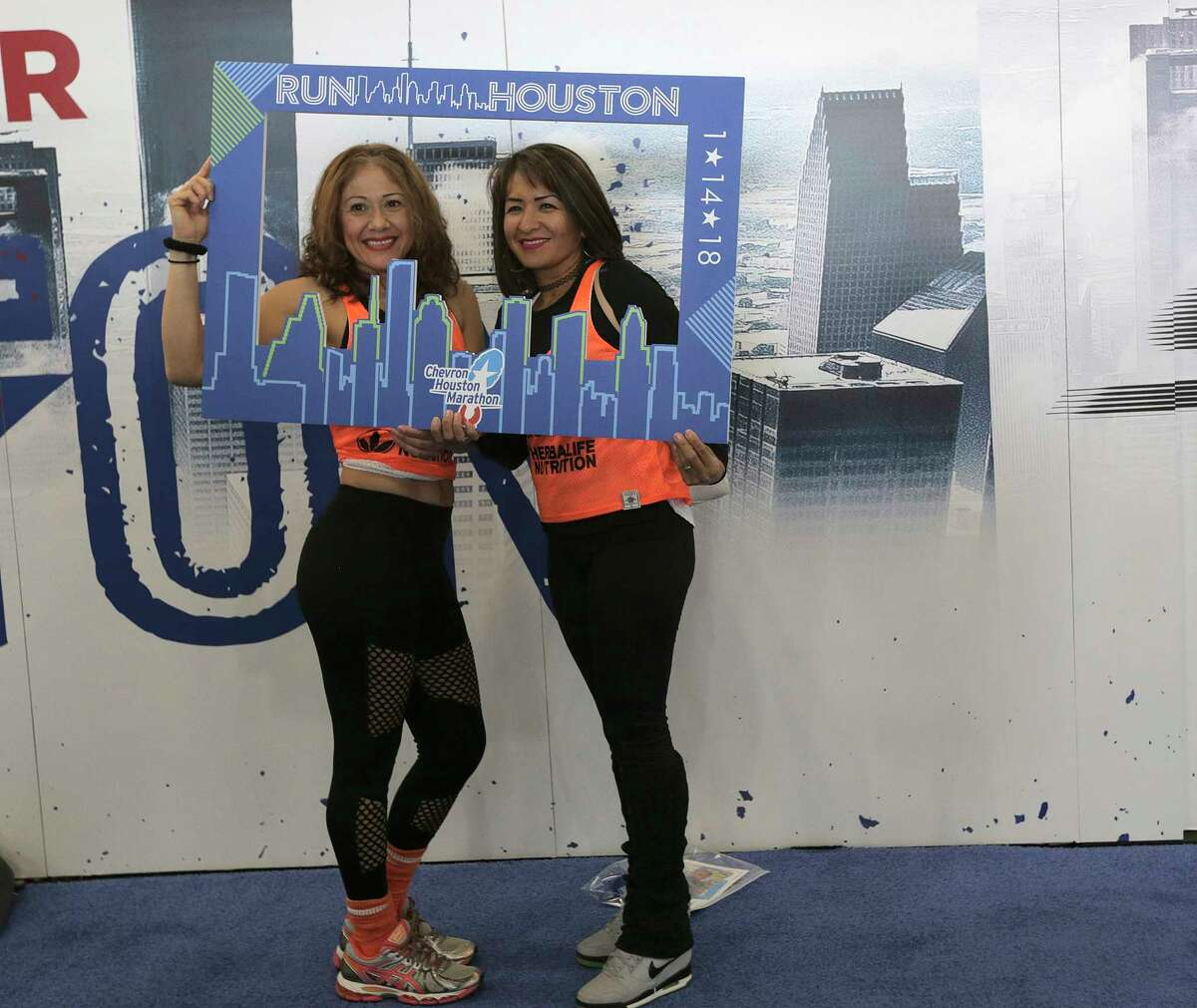 Blanca Villarreal, left, and Erika Clemente pose for a photo in the expo for the 2018 Chevron Houston Marathon and Aramco Houston Half Marathon at George R. Brown Convention Center on Friday, Jan. 12, 2018, in Houston. ( Elizabeth Conley / Houston Chronicle )