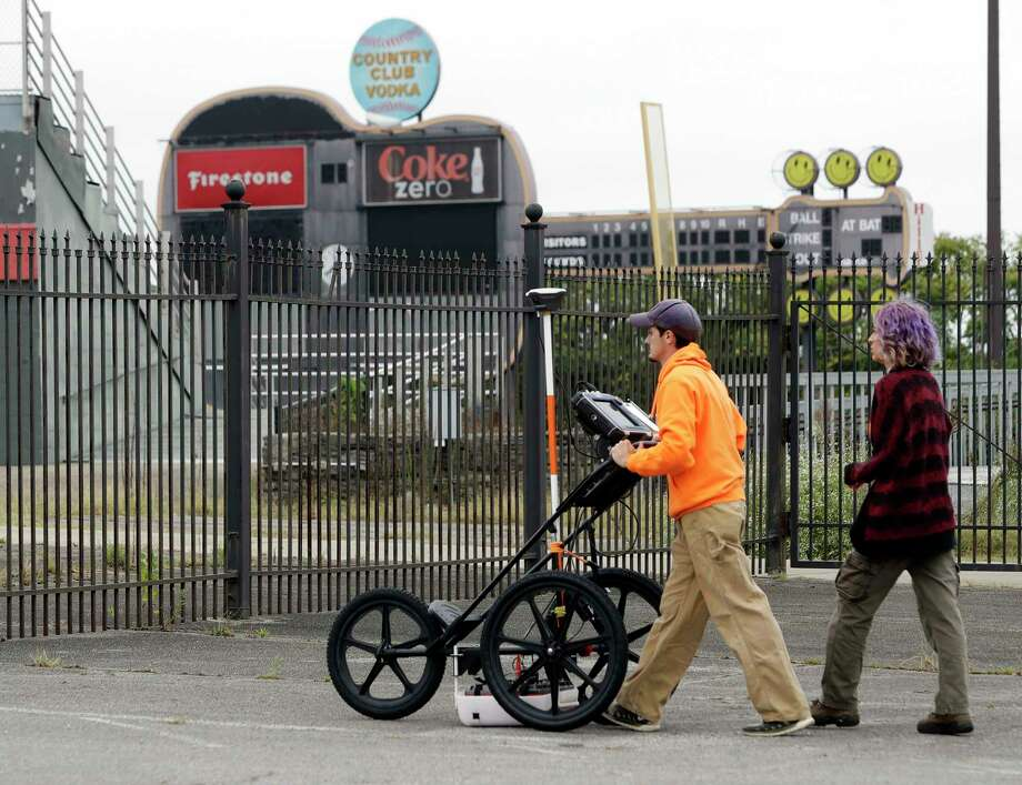 FILE - In this Oct. 12, 2017 file photo, Greer Stadium field technicians Chandler Burchfield, left, and Cristina Oliveira use ground penetrating radar at a former minor league baseball park, in Nashville, Tenn. Developers Cloud Hill Partnership said Friday, Jan. 12, 2018, that the site is no longer viable for a commercial and residential project because archaeologists discovered what they believe are the graves of slaves at a nearby Civil War site. (AP Photo/Mark Humphrey, File) Photo: Mark Humphrey, STF / Copyright 2017 The Associated Press. All rights reserved.