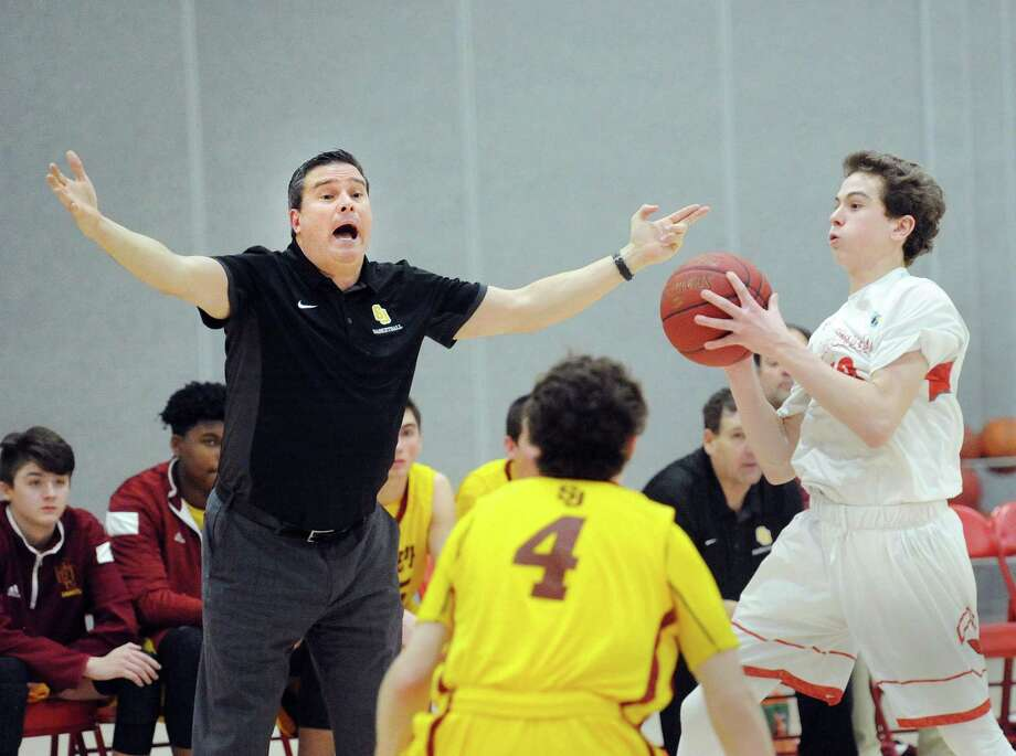 At right, Gavin Muir of Greenwich looks to pass while being defended by Dan Tobin (#4) of St. Joseph, center, as St. Joseph basketball coach Paul Dudzinski reacts during the boys high school basketball game between Greenwich High School and St. Joseph High School at Greenwich, Conn., Friday night, Jan. 12, 2018. Photo: Bob Luckey Jr. / Hearst Connecticut Media / Greenwich Time