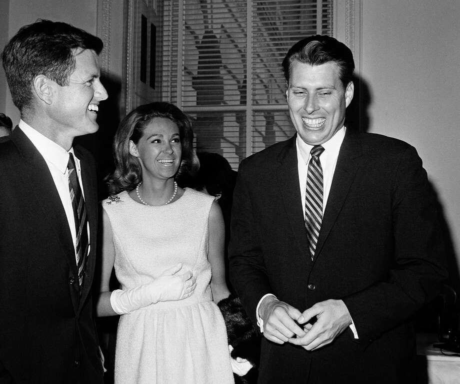 """John Tunney (right) shares a light-hearted moment with his former college roomate, Sen. Ted Kennedy, who remained a good friend. His campaign for a California seat in the U.S. Senate became the basis for the 1972 Robert Redford film """"The Candidate."""" Photo: Charles Gorry / Charles Gorry / Associated Press 1965 / AP1965"""