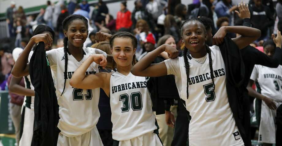 Fort Bend Hightower Hurricanes Destini Lombard (23), Ashlyne Steen (30), and Taelor Purvis (5) celebrate after winning the girls high school basketball game between the Ridge Point Panthers and the Fort Bend Hightower Hurricanes at Hightower High School in Missouri City, TX on Friday, January 12, 2018. Photo: Tim Warner/For The Chronicle