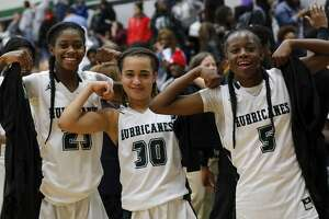 Fort Bend Hightower Hurricanes Destini Lombard (23), Ashlyne Steen (30), and Taelor Purvis (5) celebrate after winning the girls high school basketball game between the Ridge Point Panthers and the Fort Bend Hightower Hurricanes at Hightower High School in Missouri City, TX on Friday, January 12, 2018.