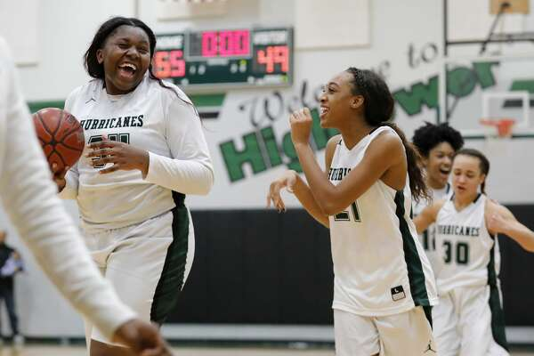 Fort Bend Hightower Hurricanes center Winnie Kuimi (34) and Victoria Chidomere (21) after winning the girls high school basketball game between the Ridge Point Panthers and the Fort Bend Hightower Hurricanes at Hightower High School in Missouri City, TX on Friday, January 12, 2018.