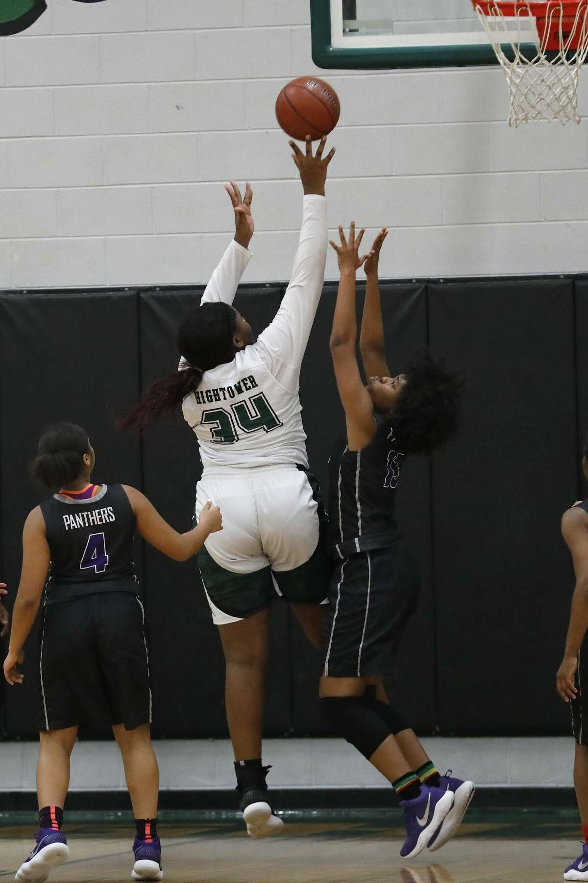 Fort Bend Hightower Hurricanes center Winnie Kuimi (34) shoots the ball defended by Ridge Point Panthers Alex Williams (13) in the first half during the girls high school basketball game between the Ridge Point Panthers and the Fort Bend Hightower Hurricanes at Hightower High School in Missouri City, TX on Friday, January 12, 2018.