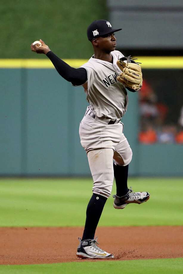 HOUSTON, TX - OCTOBER 20:  Didi Gregorius #18 of the New York Yankees throws out Jose Altuve #27 of the Houston Astros during the first inning in Game Six of the American League Championship Series at Minute Maid Park on October 20, 2017 in Houston, Texas.  (Photo by Elsa/Getty Images) ORG XMIT: 775058088 Photo: Elsa / 2017 Getty Images