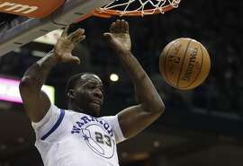 Golden State Warriors' Draymond Green dunks during the first half of an NBA basketball game against the Milwaukee Bucks Friday, Jan. 12, 2018, in Milwaukee. (AP Photo/Morry Gash)