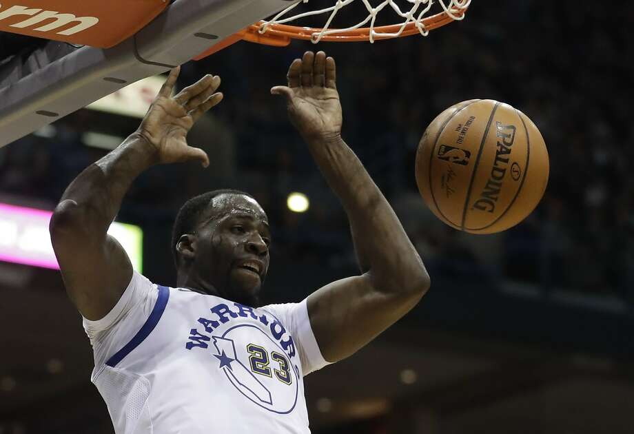 Golden State Warriors' Draymond Green dunks during the first half of an NBA basketball game against the Milwaukee Bucks Friday, Jan. 12, 2018, in Milwaukee. Photo: Morry Gash, Associated Press