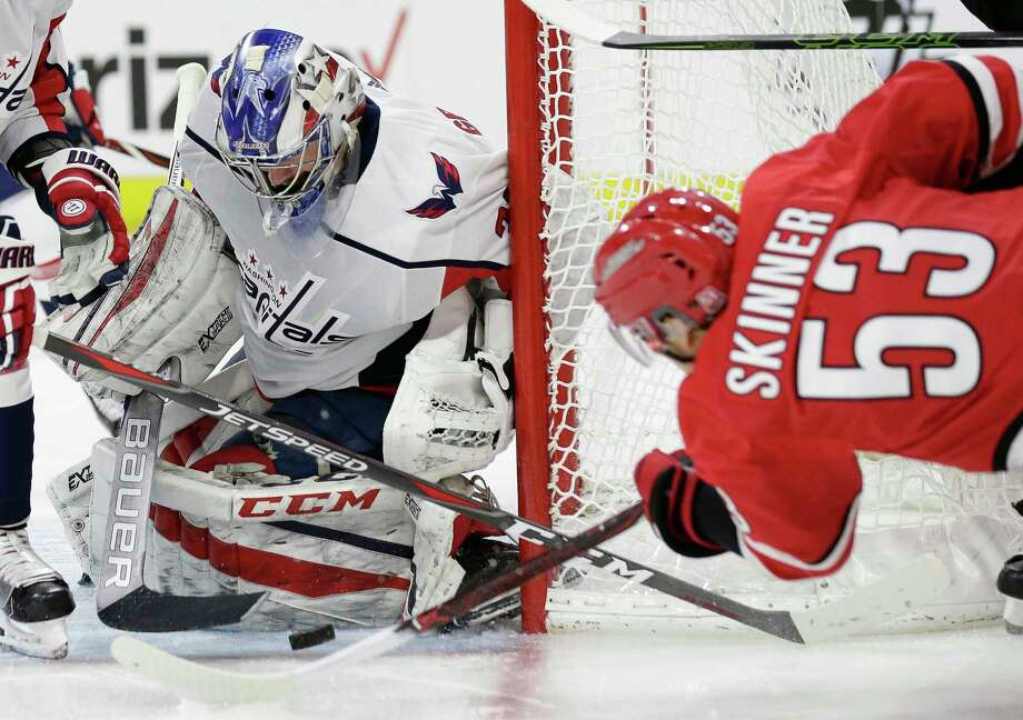 Washington Capitals goalie Philipp Grubauer (31), of Germany, blocks a shot on goal by Carolina Hurricanes' Jeff Skinner (53) during the second period of an NHL hockey game in Raleigh, N.C., Friday, Jan. 12, 2018. (AP Photo/Gerry Broome) Photo: Gerry Broome / Copyright 2018 The Associated Press. All rights reserved.