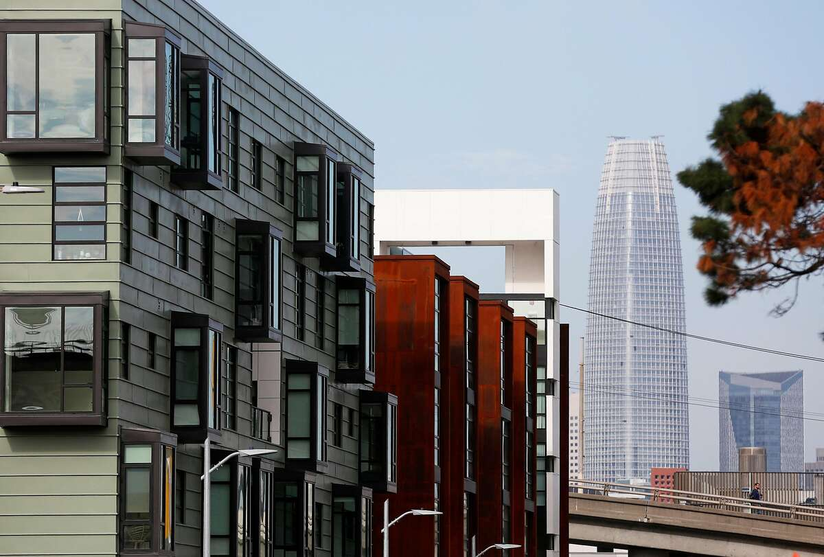 Salesforce tower peeks out behind O + M apartments at 800 Indiana Street on Thursday, Jan. 11, 2018 in the Dogpatch neighborhood of San Francisco, Calif.