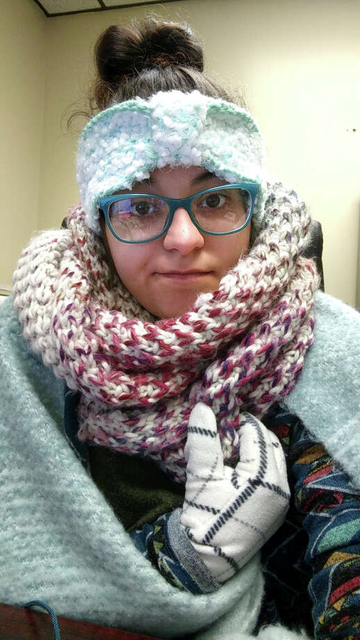 Rebecca Miller, an academic adviser at Tennessee State University, wears sweaters, a scarf, ear coverings, gloves and a blanket over her lap while she works at her desk in Holland Hall on campus in Nashville.  Rebecca Miller, an academic adviser at Tennessee State University, wears sweaters, a scarf, ear coverings, gloves and a blanket over her lap while she works at her desk in Holland Hall on campus in Nashville. Photo: Rebecca Miller, HONS / Rebecca Miller