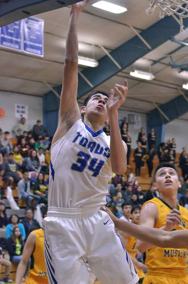 Jorge Salazar scored 11 points and grabbed four boards as Cigarroa (11-18, 7-4 district) ended its four-game skid with a 57-55 win over Sharyland. Photo: Cuate Santos /Laredo Morning Times File / Laredo Morning Times