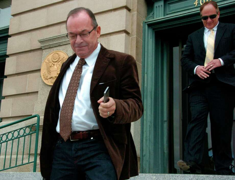 Tim Blixseth, left, leaves a courthouse in 2014 after facing questions about his finances in Butte, Mont. Photo: Matthew Brown, STF / Copyright 2018 The Associated Press. All rights reserved.