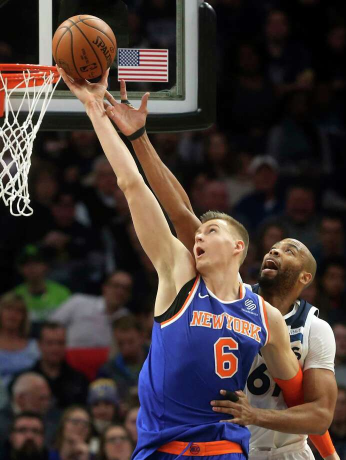 New York Knicks' Kristaps Porzingis, left, of Latvia, outreaches Minnesota Timberwolves' Taj Gibson as he lays up in the first half of an NBA basketball game Friday, Jan. 12, 2018, in Minneapolis. (AP Photo/Jim Mone) Photo: Jim Mone / Copyright 2018 The Associated Press. All rights reserved.