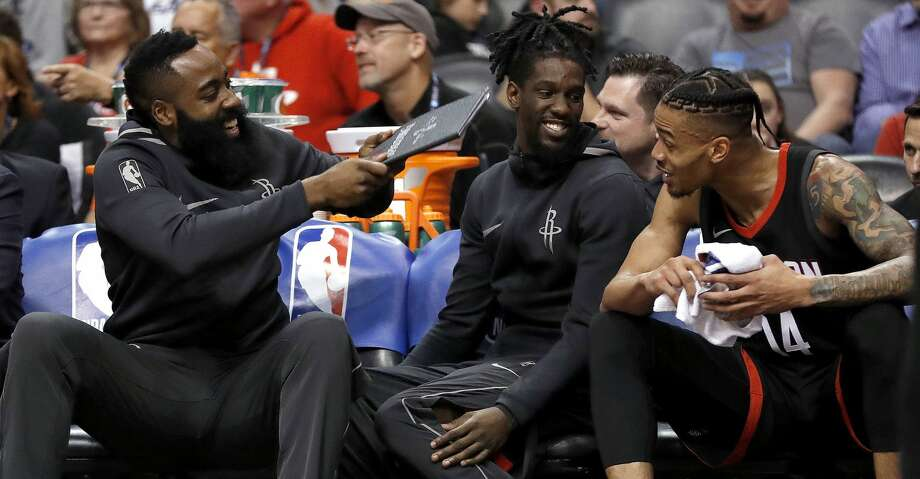 Houston Rockets guard James Harden, left, playfully fans his teammates on the bench during the first half of the team's NBA basketball game against the Phoenix Suns, Friday, Jan. 12, 2018, in Phoenix. (AP Photo/Matt York) Photo: Matt York/Associated Press