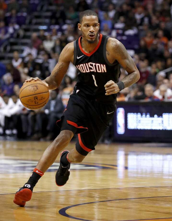 Rockets forward Trevor Ariza (1) left Sunday's game against the Suns early with a hamstring injury. Photo: Matt York/Associated Press