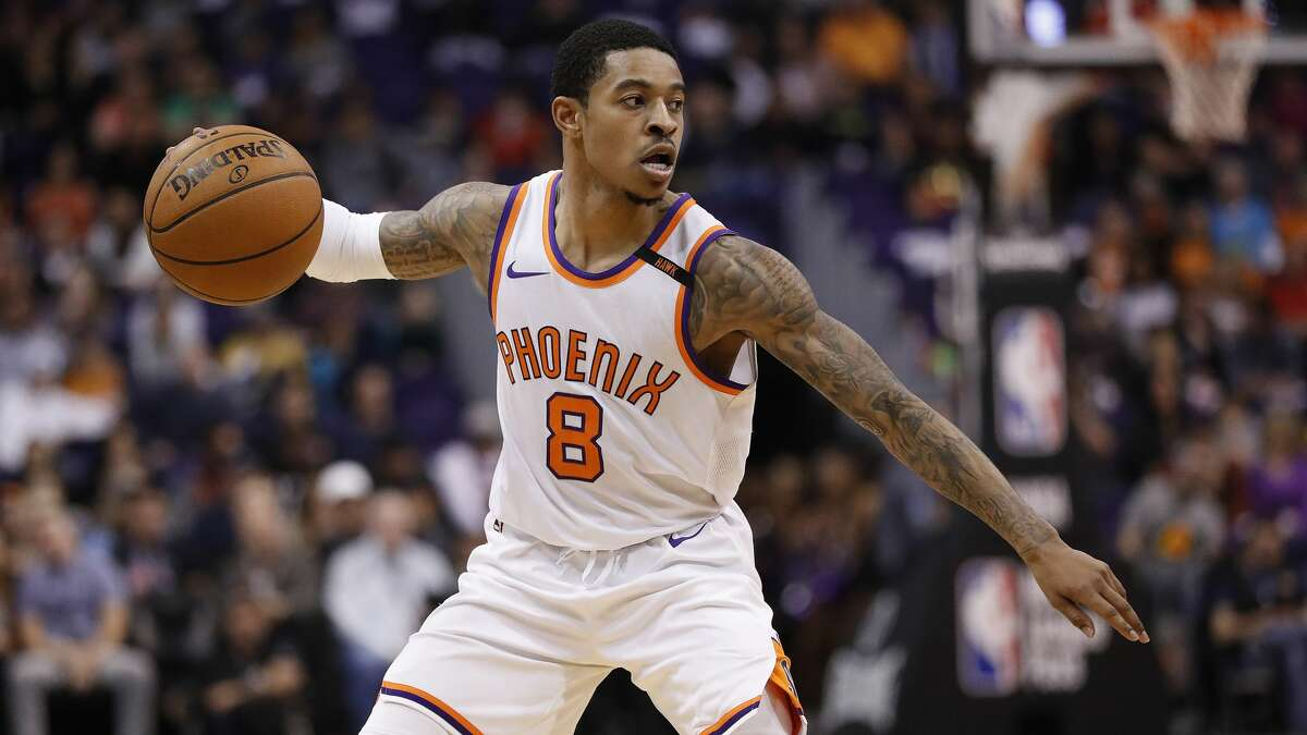 Phoenix Suns guard Tyler Ulis (8) looks to pass against the Houston Rockets during the second half of an NBA basketball game, Friday, Jan. 12, 2018, in Phoenix. (AP Photo/Matt York)
