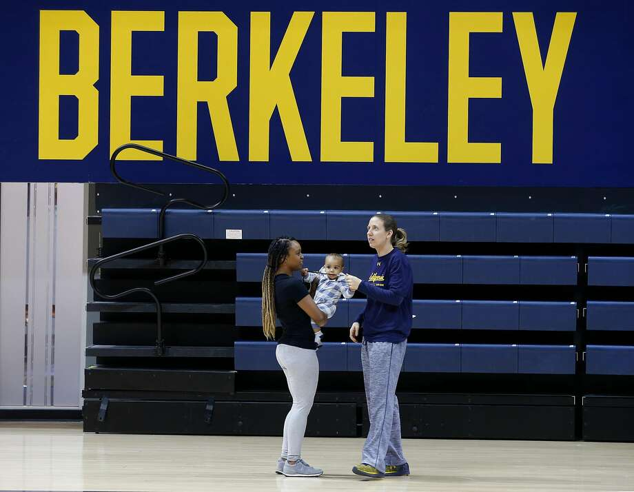 "Nanny Angie Lockett holds then-6-month-old Jordan while his mom, Lindsay Gottlieb, runs a Cal practice. Having Jordan at work makes Gottlieb ""more engaged and happy to be here."" Photo: Paul Chinn, The Chronicle"