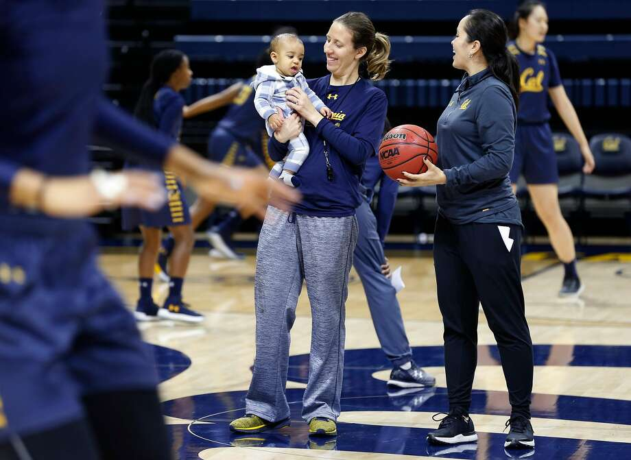 Cal coach Lindsay Gottlieb holds her son Jordan, who gets a lot of attention from players and staff members at practices, including assistant coach Kai Felton (right). Photo: Paul Chinn, The Chronicle
