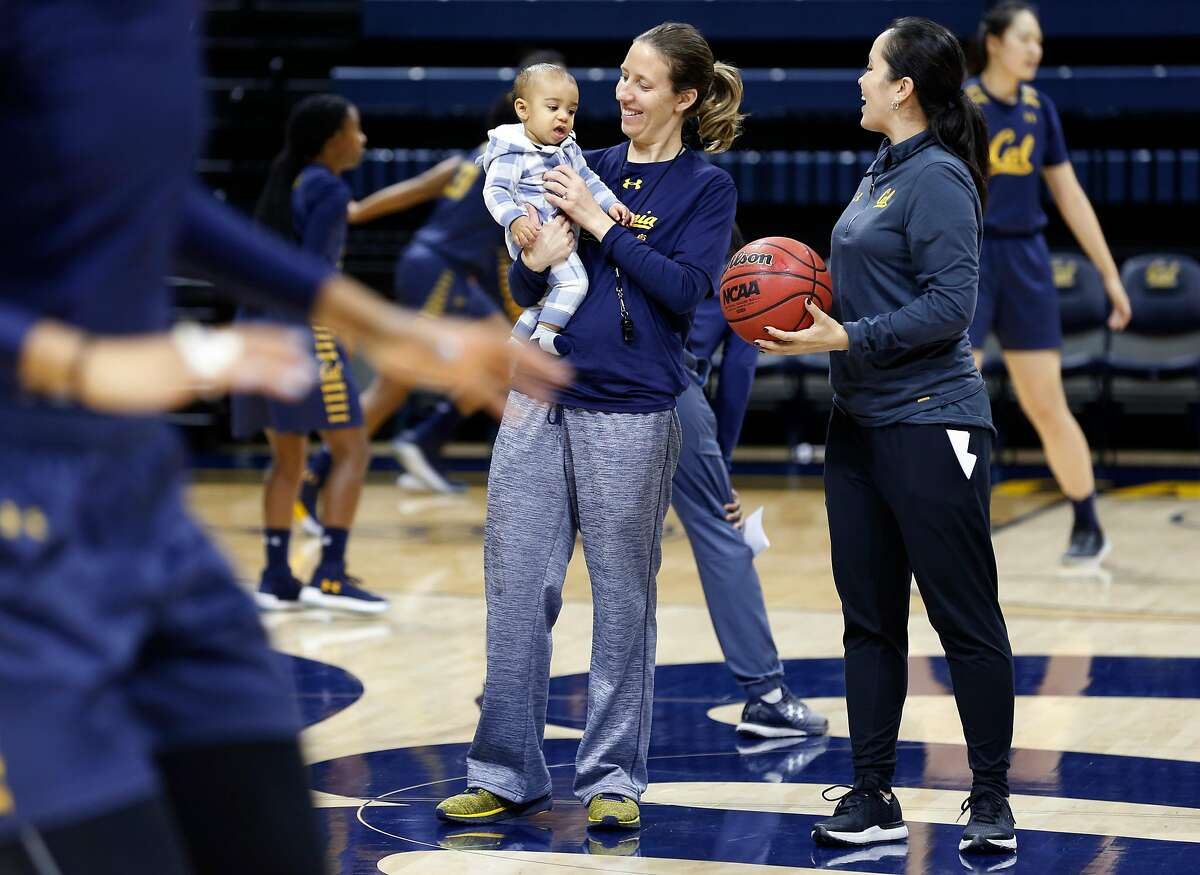 Head coach Lindsay Gottlieb holds her 6-month-old son Jordan while conducting a Cal women's basketball practice with assistant coach Kai Felton (right) at UC Berkeley on Wednesday, Nov. 29, 2017.