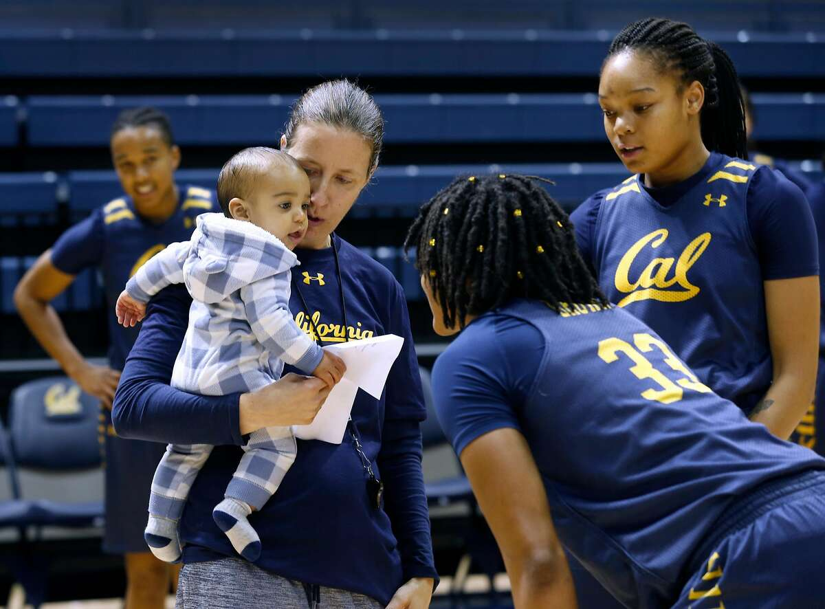 Head coach Lindsay Gottlieb�s 6-month-old son Jordan draws the attention of players during a Cal women's basketball practice at UC Berkeley on Wednesday, Nov. 29, 2017.