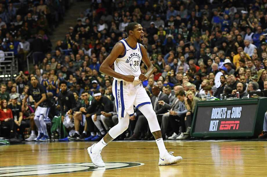 Kevin Durant celebrates a three-point shot by Draymond Green during the second half of the Warriors' game against the Bucks. Photo: Stacy Revere / Stacy Revere / Getty Images / 2018 Stacy Revere