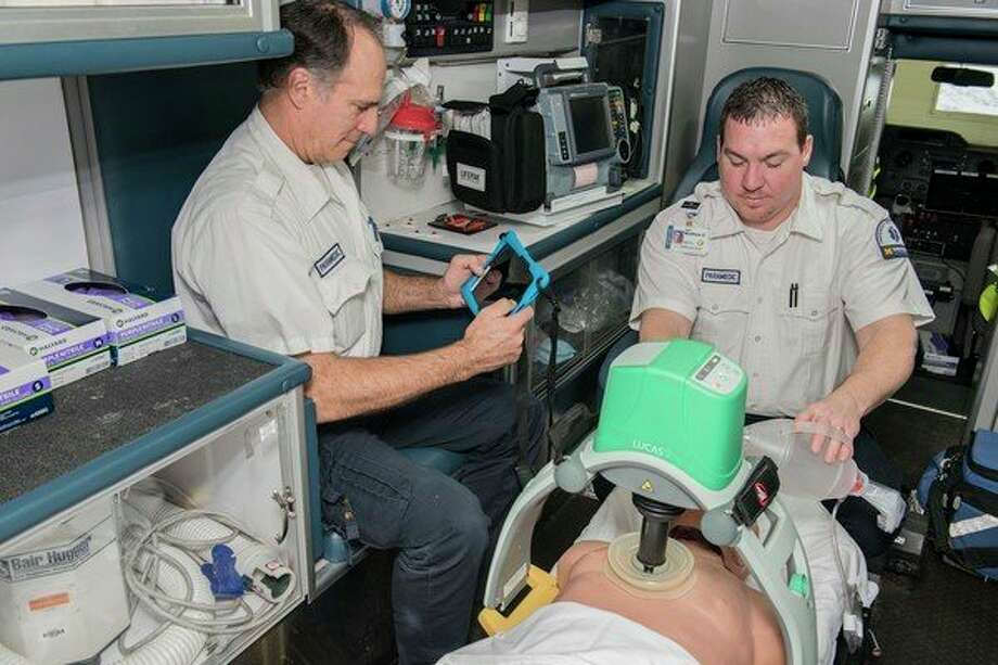 MidMichigan Medical Center - Emergency Medical Services Paramedics Martin Peters, left, and Matthew DeBrosse demonstrate how the new LUCAS technology is used for patients in cardiac arrest. (Photo provided)