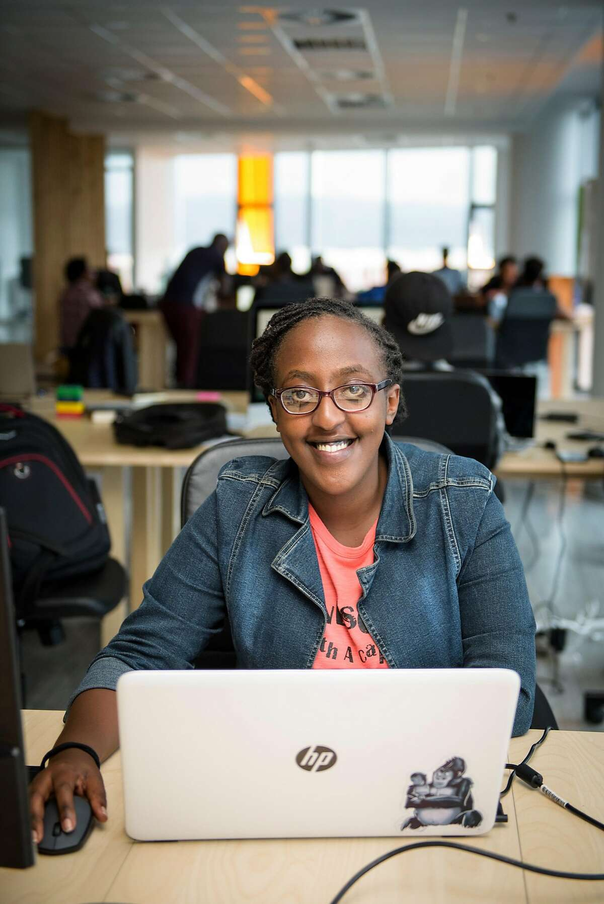 Fileille Naberwe, 20, at DMM Hehe on Nov 17, 2017 in Kigali, Rwanda. She is a dev-opps fellow at DMM Hehe Hehe, formerly known as Hehe Labs. DMM Hehe, formerly known as Hehe Labs on 17 Nov 2017 in Kigali, Rwanda. The start-up seeks to provide young Rwandans with technology skills.