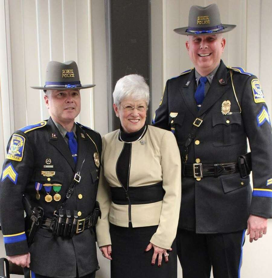 Connecticut State Police promoted 10 troopers Thursday, including, Sgts. Matt Ewing, left, and Myles Ginley, right. Lt. Gov. Nancy Wyman, center, congratulated the officers during the pinning ceremony at state police headquarters in Middletown. Photo: Contributed Photo