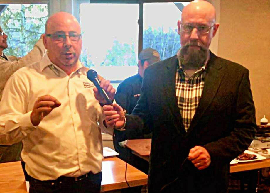 CEO of Powder Ridge Mountain Park & Resort Sean Hayes, left, welcomed over 225 guests to the Middlesex Chambers January Business After Work Wednesday. Co-owner of Eli Cannons Tap Room Phil Ouellette, right, emceed a Restaurant Showdown, the kickoff to the Taste of Middlesex Restaurant Week, which runs through Jan. 21. Photo: Contributed Photo