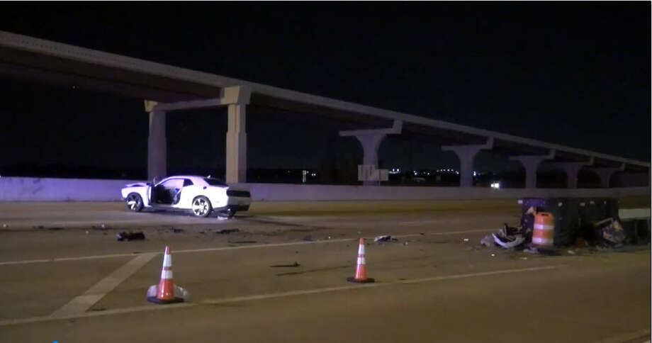 An unidentified driver was injured after hitting a barricade Saturday morning and spinning into the main lanes of the Katy Freeway, according to authorities. Photo: Metro Video