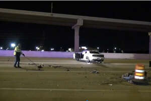An unidentified driver was injured after hitting a barricade Saturday morning and spinning into the main lanes of the Katy Freeway, according to authorities.