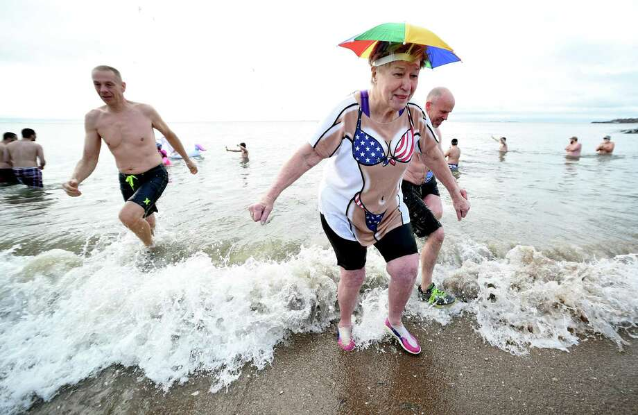Sandy Kline (right) of New Haven emerges from the water during the 18th annual Icy Plunge for the Cure to benefit the West Haven Breast Cancer Awareness Program at Savin Rock Beach in West Haven on January 13, 2018. Photo: Arnold Gold / Hearst Connecticut Media / New Haven Register