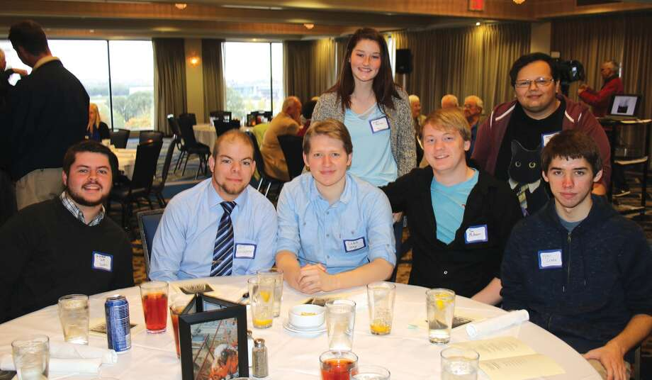 Members of the Southwestern Illinois College STEM Scholars program won the first-ever Richard Bowser Engineering Competition awarded at the recent Arch Builders Reunion banquet in St. Louis. Pictured, from left, seated, are SWIC students Chandler Scott of Scott Air Force Base, Josh Westenberger of Baldwin, Caleb Gray of Maryville, Joe McKinnon and Tyler Cronin, both of Troy; standing are, Jayda Pearman of Sparta and Kevin Brutto of Collinsville. Not pictured, student Ana Flores-Garcia of Collinsville and SWIC Associate Professor of Mathematics Jennifer Simonton, the faculty coordinator of the project, also particiapted. The competition, named for Arch tram designer Richard Bowser, challenged teams of college engineering students to modernize the way power is supplied to the Arch tram capsules to make it safer for the mechanics to perform maintenance on the system. SWIC STEM Scholars won with their proposal to convert the system to battery power. The teams were previously given a behind-the-scenes tour of the Gateway Arch tram system. SWIC competed against teams from Washington University and Southern Illinois University Edwardsville. The SWIC STEM Scholars program provides a select group of students a full-ride scholarship to study science, technology, engineering and math disciplines. In addition, these students are paired with faculty mentors, participate in study groups, take part in off-campus activities, such as college visits, and enroll in special topics courses. SWIC received a more than $600,000 National Science Foundation S-STEM grant to develop the STEM Scholars Program. Photo: For The Intelligencer